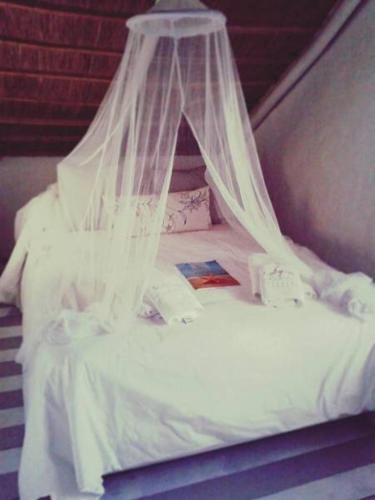 A bed or beds in a room at Posada Valizas