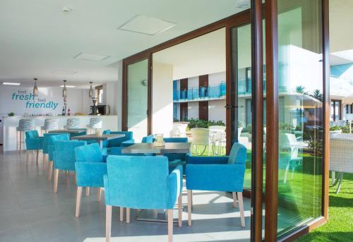 Restaurant ou autre lieu de restauration dans l'établissement Aparthotel Ferrer Skyline