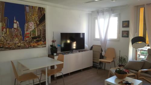 A television and/or entertainment centre at Apartamento Oxford