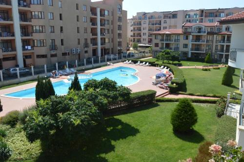 A view of the pool at Arcadia Apart Complex or nearby