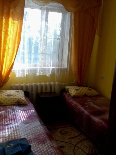A bed or beds in a room at Аmto Mil'kovo