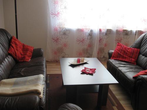 Ein Sitzbereich in der Unterkunft Ferienwohnung auf dem Bünberg