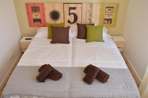 A bed or beds in a room at AD Hostel Rooms Tarragona