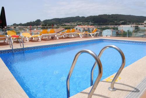 The swimming pool at or close to Apartamentos Riveiro