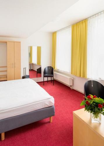 A room at CVJM Düsseldorf Hotel & Tagung