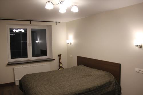 A bed or beds in a room at Max apartment at Varshavskaya 6
