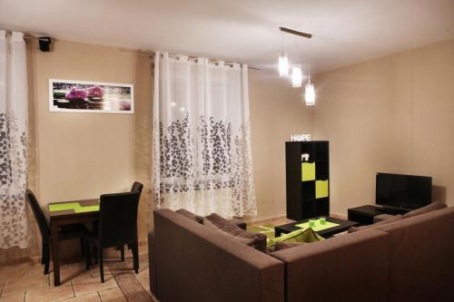 Restoranas ar kita vieta pavalgyti apgyvendinimo įstaigoje Apartament Milena