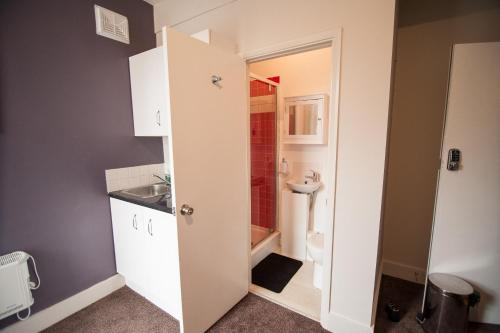 A kitchen or kitchenette at Vision Suites