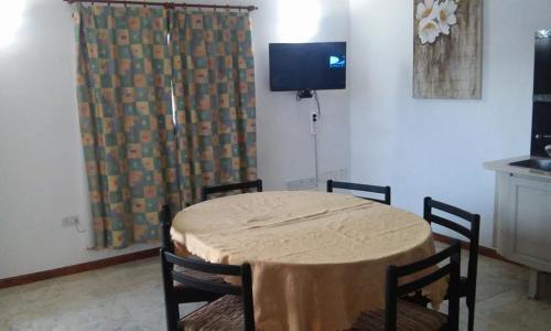 Una televisión o centro de entretenimiento en Apartamento Camicande