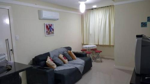 A seating area at Apartamento em Aracaju - Sergipe
