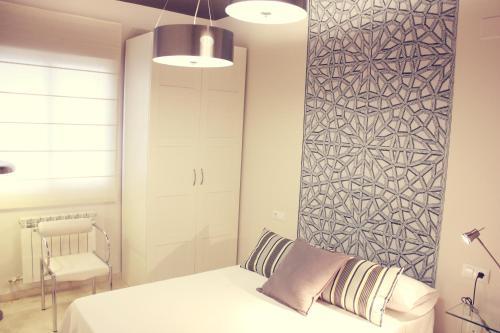 A bed or beds in a room at Apartamento en el centro de Montilla