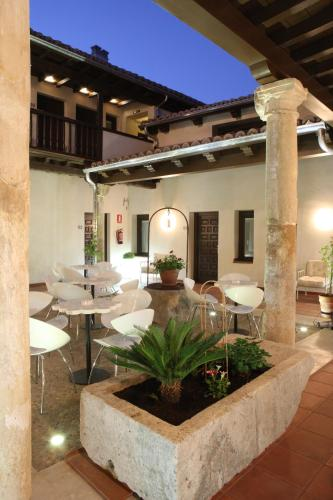 A patio or other outdoor area at Evenia Alcalá Boutique Hotel