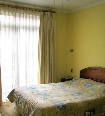 A bed or beds in a room at Posada del Salvador