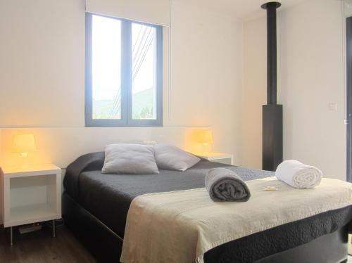 Uma cama ou camas num quarto em Casa Das Furnas
