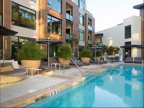 The swimming pool at or near Global Luxury Suites at Downtown Mountain View
