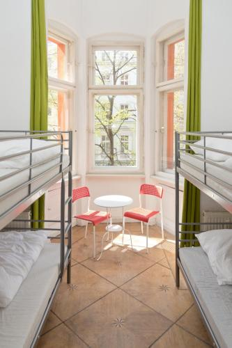 A bunk bed or bunk beds in a room at Happy Hostel Berlin