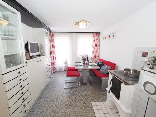 A kitchen or kitchenette at Apart Al Aua