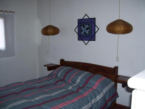 Una cama o camas en una habitación de Casa Abedules de los Andes