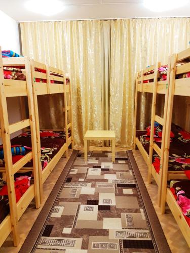 A bunk bed or bunk beds in a room at Hostel Uyt in Kursk