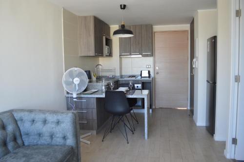 Una cocina o zona de cocina en Midtown Apartments