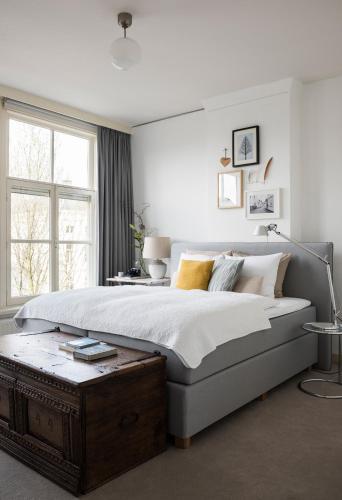 Кровать или кровати в номере De Hoedenmaker