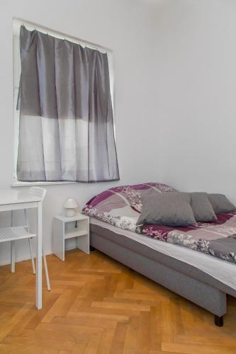 A bed or beds in a room at Metro Centrum Guest Rooms
