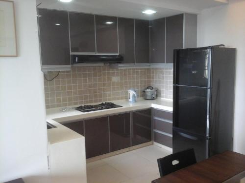 A kitchen or kitchenette at Kempas Apartment, Genting View Resort