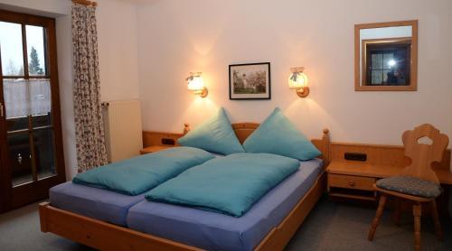 Ein Bett oder Betten in einem Zimmer der Unterkunft Landhaus Hohenschwangau
