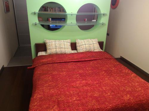 Giường trong phòng chung tại Apartment on Gerasima Kurina 20