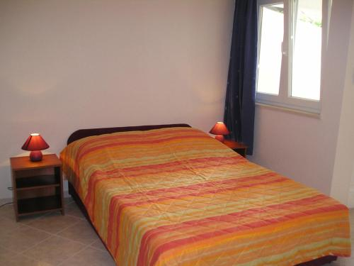 A bed or beds in a room at Vanda Seafront Studio