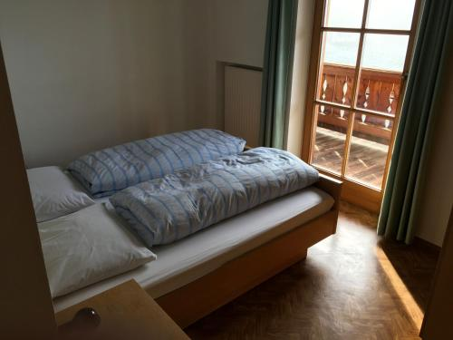 A bed or beds in a room at Fallerhof