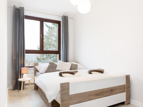 Łóżko lub łóżka w pokoju w obiekcie ASTI PREMIUM APARTCOMPLEX GŁOWACKIEGO