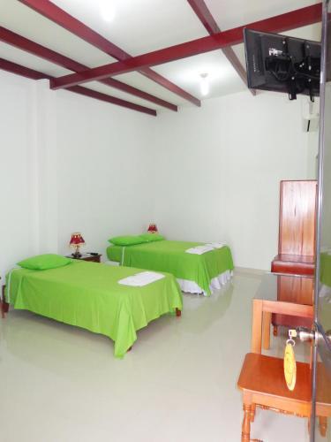 A bed or beds in a room at El Mirador