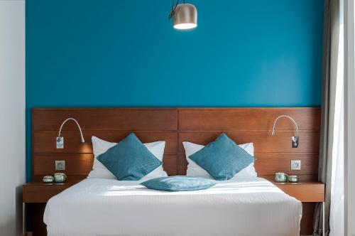 A bed or beds in a room at Aparthotel Residence Agenda