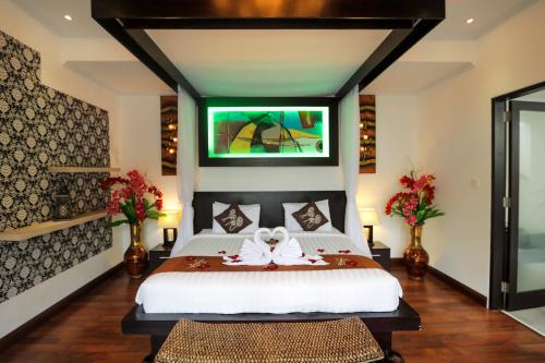 A bed or beds in a room at Blue Marlin Legian Villa