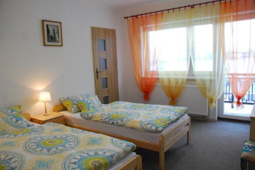 Posteľ alebo postele v izbe v ubytovaní Privát Voyage