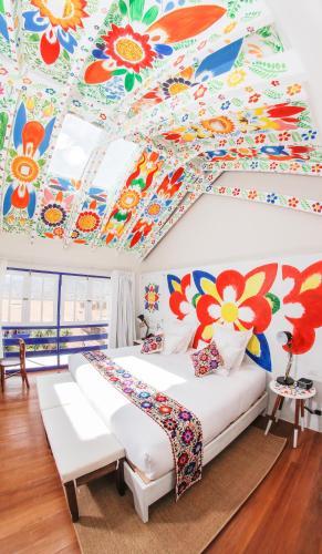 Cama o camas de una habitación en El Retablo
