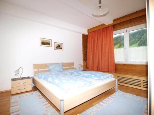 Ein Bett oder Betten in einem Zimmer der Unterkunft Ferienwohnung Mondial