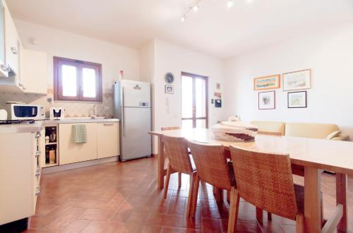 A kitchen or kitchenette at Apartments Laconi