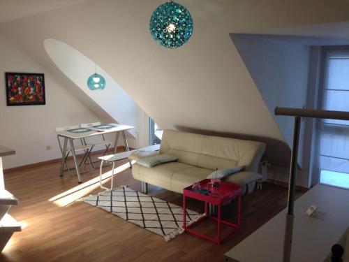 A seating area at Apartment Ochsenfurt