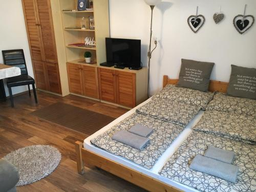 A bed or beds in a room at Blue River Apartment