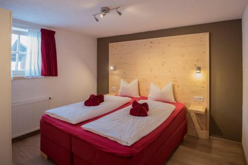 מיטה או מיטות בחדר ב-Haus Alpenblick Lofer