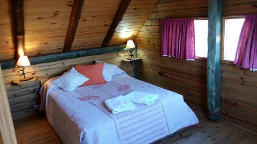 Una cama o camas en una habitación de Solar de Piedra
