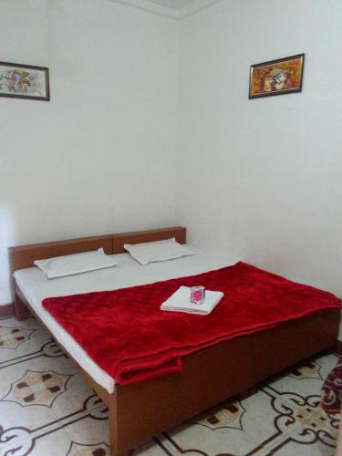 A bed or beds in a room at Temple View Guest House