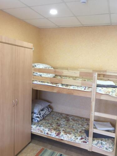 A bunk bed or bunk beds in a room at Hostel V Tapochkakh