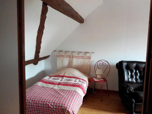 Un ou plusieurs lits dans un hébergement de l'établissement Gite duplex du vignoble Alsace