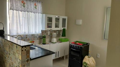 A kitchen or kitchenette at Casa Maragogi