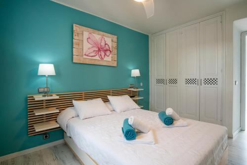 A bed or beds in a room at Ácora Ibiza