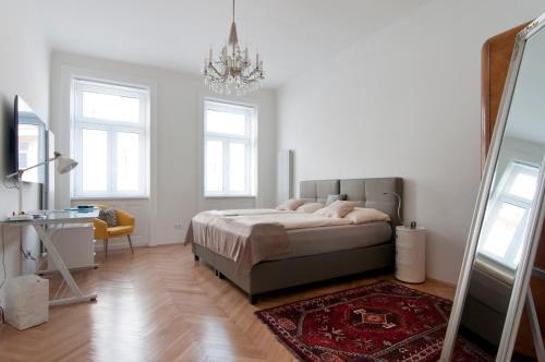 Letto o letti in una camera di Elegant Apartment Wien Messe / WU