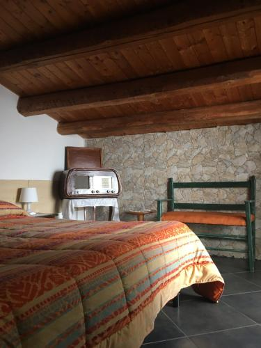 Letto o letti in una camera di Bed and Breakfast Araba Fenice